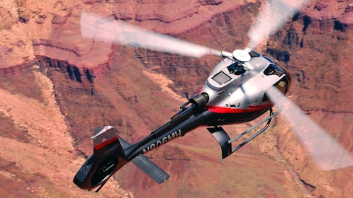 Closeup photo of the Mustang helicopter hovering over the Grand Canyon