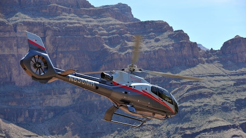 Mustang Helicopter taking off to journey the Grand Canyon