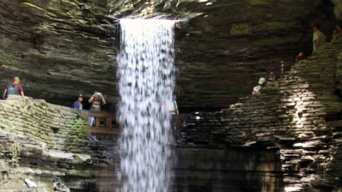 Visitors at a waterfall at Watkins Glen State Park in New York