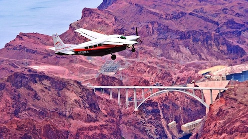 Ride along a Maverick airplane over Hoover Dam and the Grand Canyon
