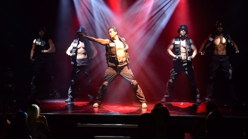 Male performers dressed in SWAT attire liven up the stage at the Thunder from Down Under in Las Vegas