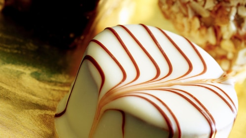 Candy covered in white icing swirled with chocolate