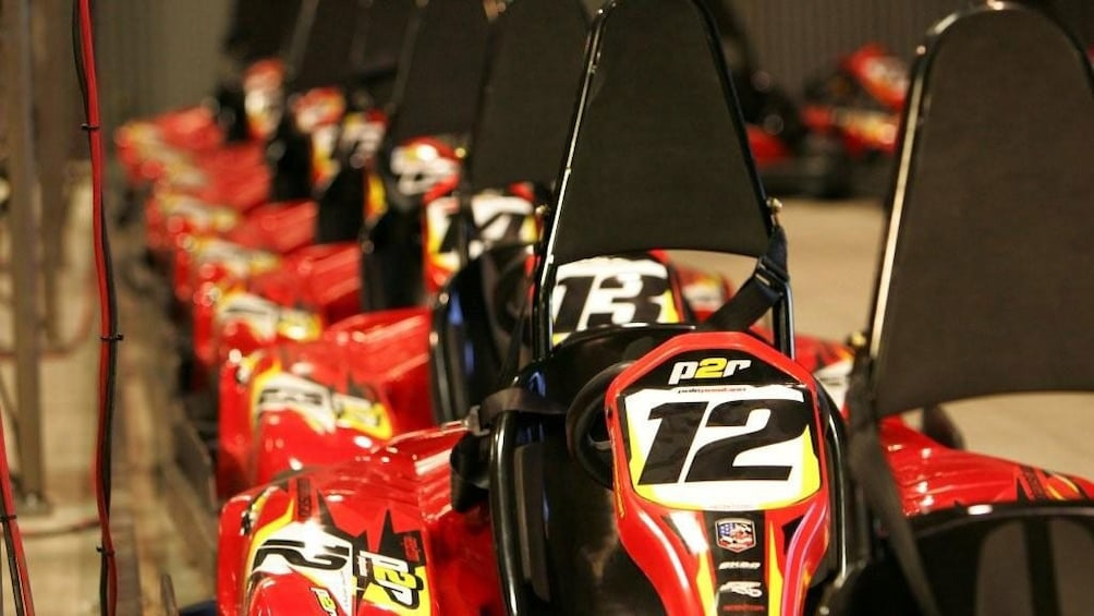 Show item 2 of 5. Close up image of the Go Karts lined up inside the raceway in Las Vegas Nevada