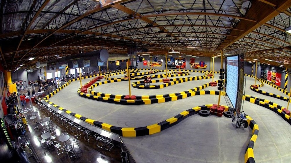 Show item 3 of 5. Wide angle view of the Indoor Go Karts raceway in Las Vegas Nevada