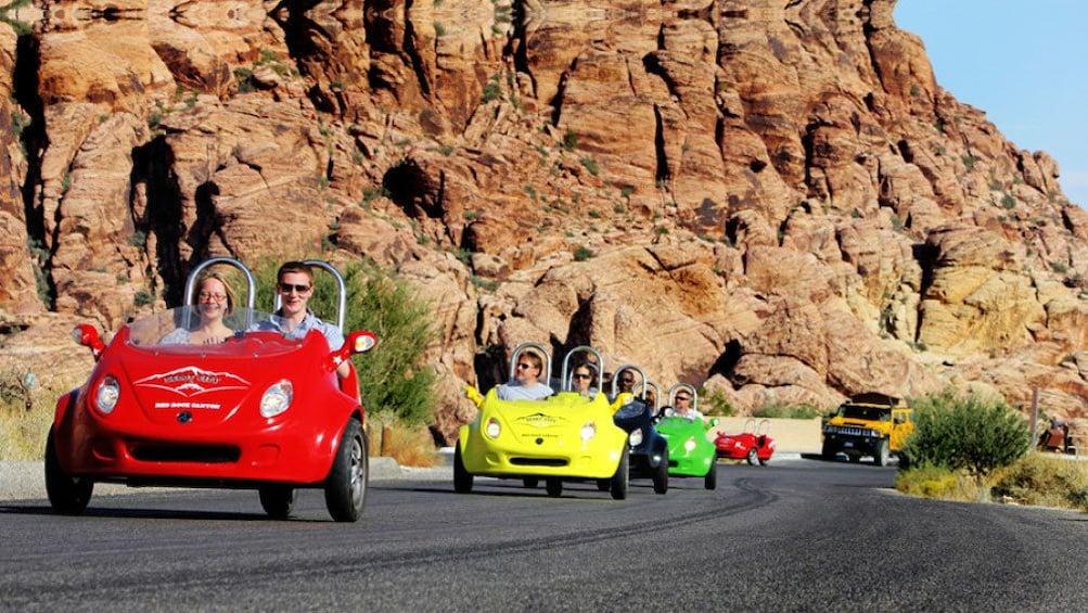 Åpne bilde 1 av 5. Guests driving in 3-wheel scootercars in Red Rock Canyon Las Vegas Nevada
