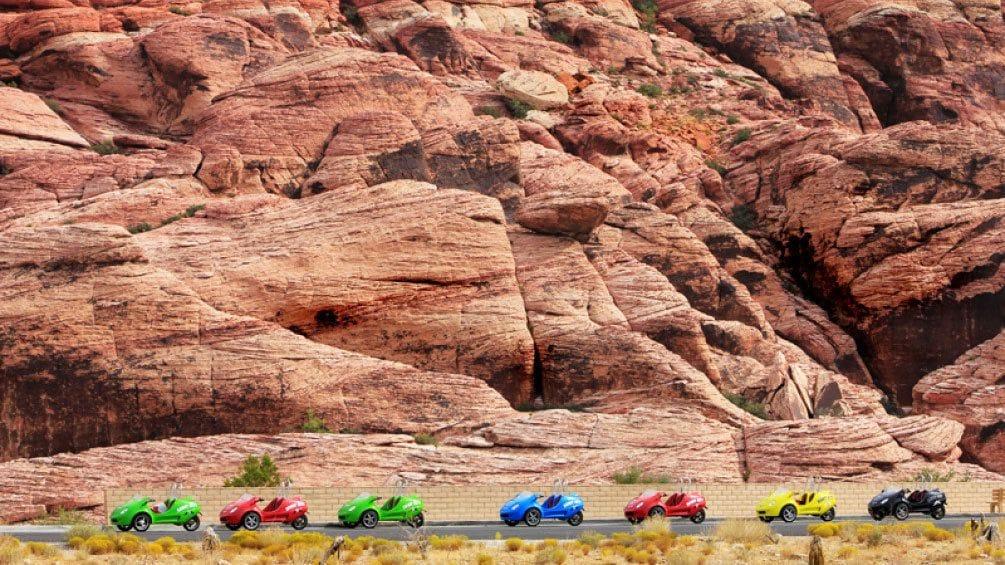 Åpne bilde 3 av 5. Landscape view of 3-wheel scootercars driving around Red Rock Canyon in Las Vegas Nevada