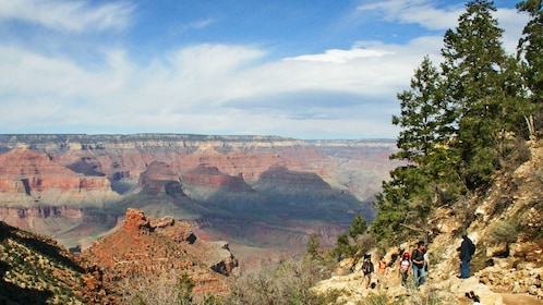 Wide angle view of the Grand Canyon with a group hiking up the canyon in Las Vegas