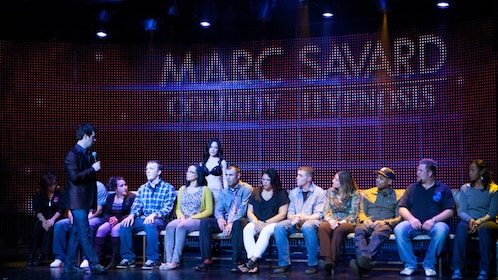 Guests on stage are looking at Marc Savard at the Marc Savard Comedy Hypnosis at Planet Hollywood Resort and Casino in Las Vegas