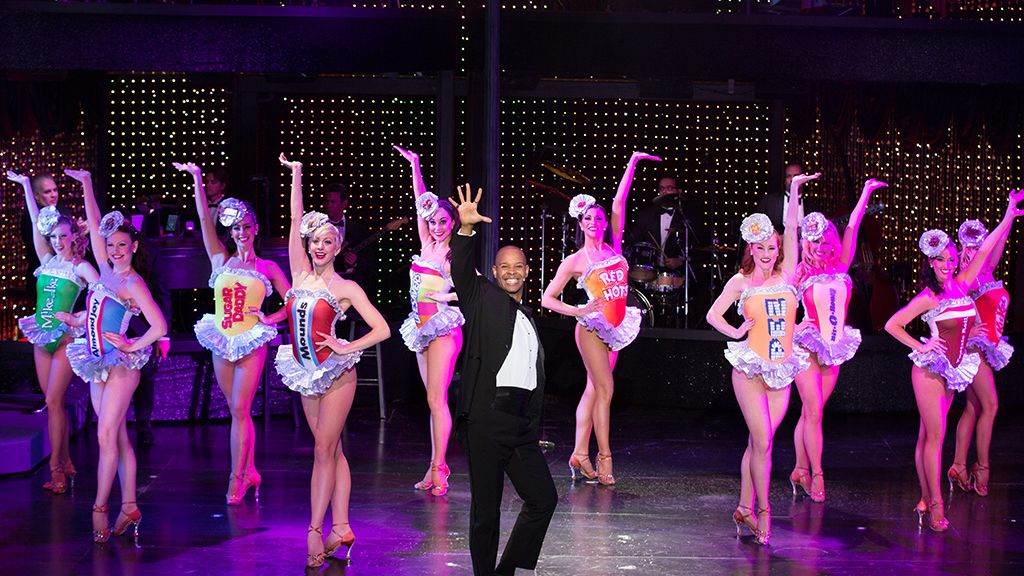 Man surrounded by dancers in Vegas The Show