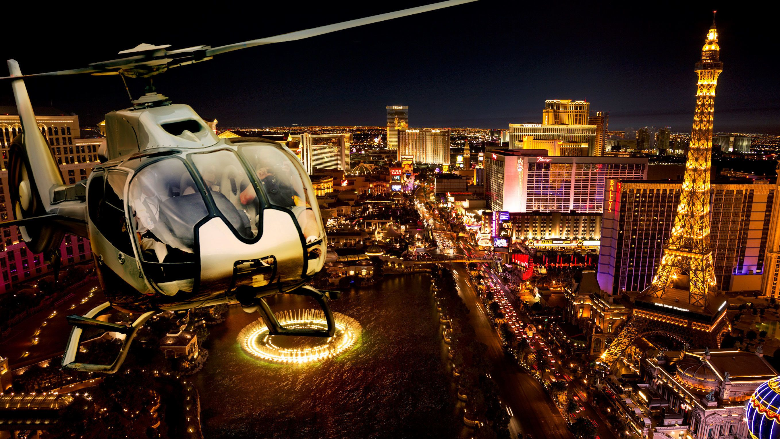 Overhead view of a helicopter on a scenic ride over the bright lights of the Strip in Las Vegas Nevada