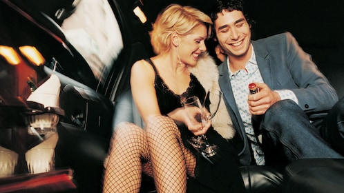 A couple inside a private limousine enjoying some champagne in Las Vegas