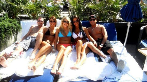 Group smiling in pool lounge chairs in Las Vegas
