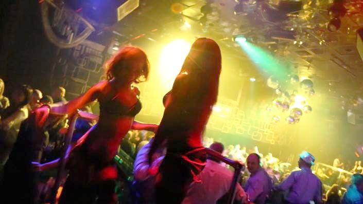 Two girls dancing inside a club in Las Vegas