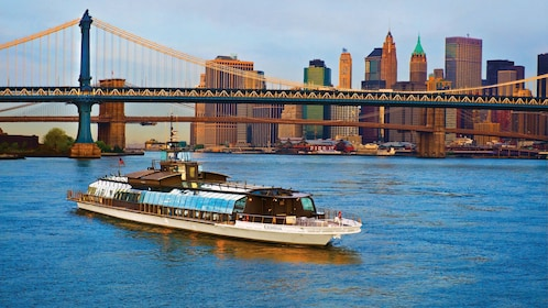 Cruise near a bridge with city in background in New York