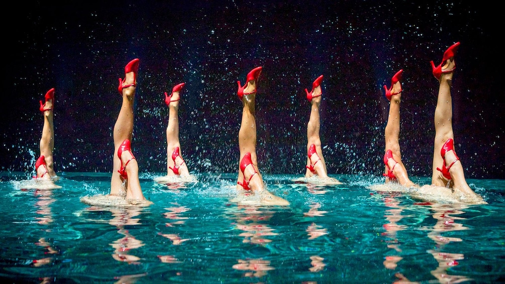 Show item 3 of 7. Synchronized swimmers performing at Le Rêve The Dream at the Wynn Las Vegas