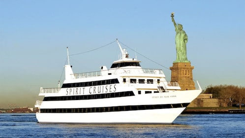 Cruise boat near the Statue of Liberty in New York