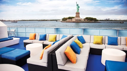 Outdoor seating on cruise boat near the Statue of Liberty in New York