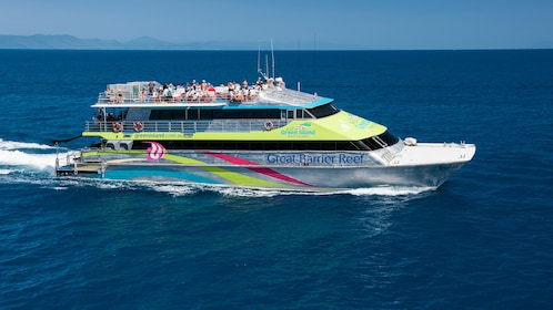 Tour group on catamaran cruise to stunning coral reefs in Cairns