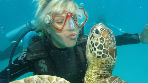 Woman snorkeling next to a sea turtle in Australia