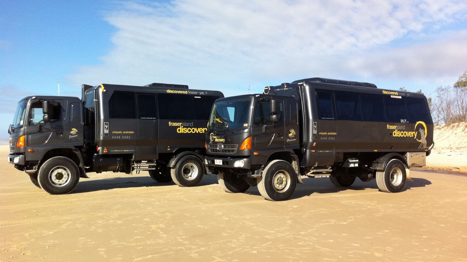Two tour buses ready for the Fraser Island Day Tour on the Sunshine Coast