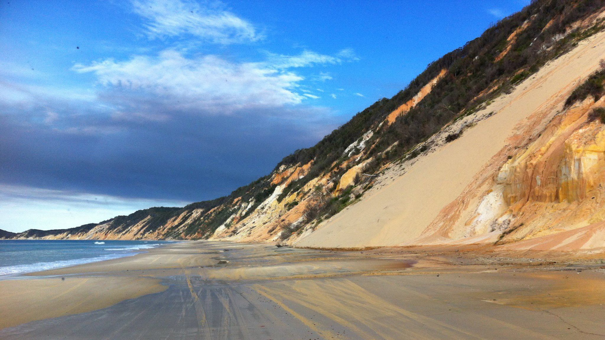 Serene view of the sand and water seen on the Fraser Island Day Tour on the Sunshine Coast