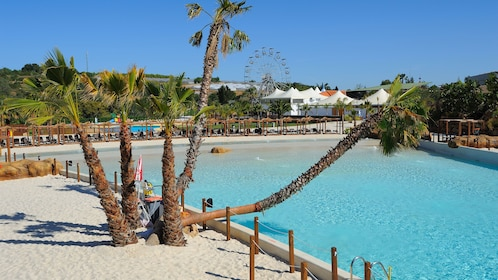 Sandy beach with ferris wheel in the background at Zoomarine Park in Algarve