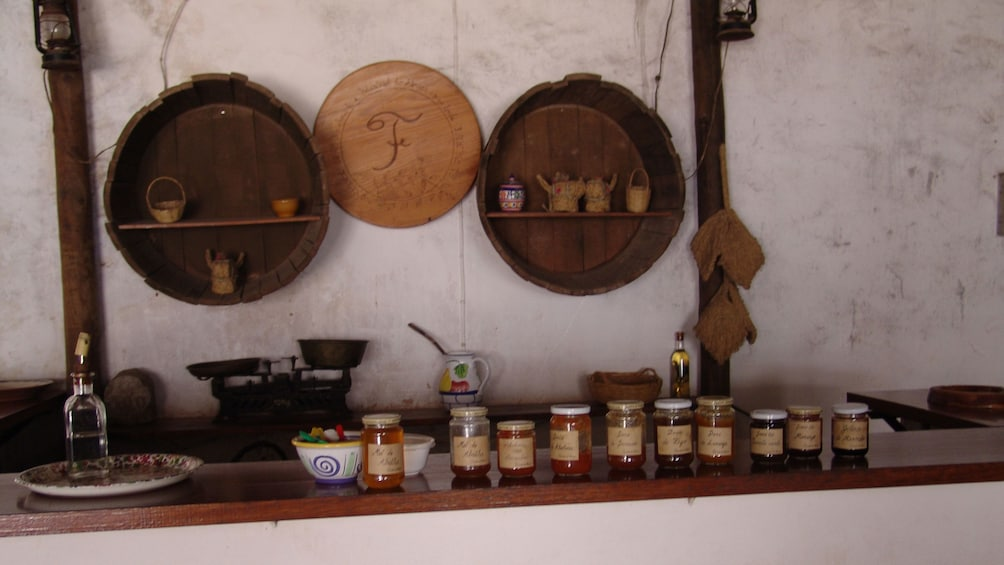Show item 2 of 5. Jars of preserves on a counter in one of the villages of the Algarve
