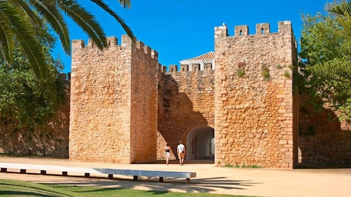 Couple walking into the Silves Castle in Silves