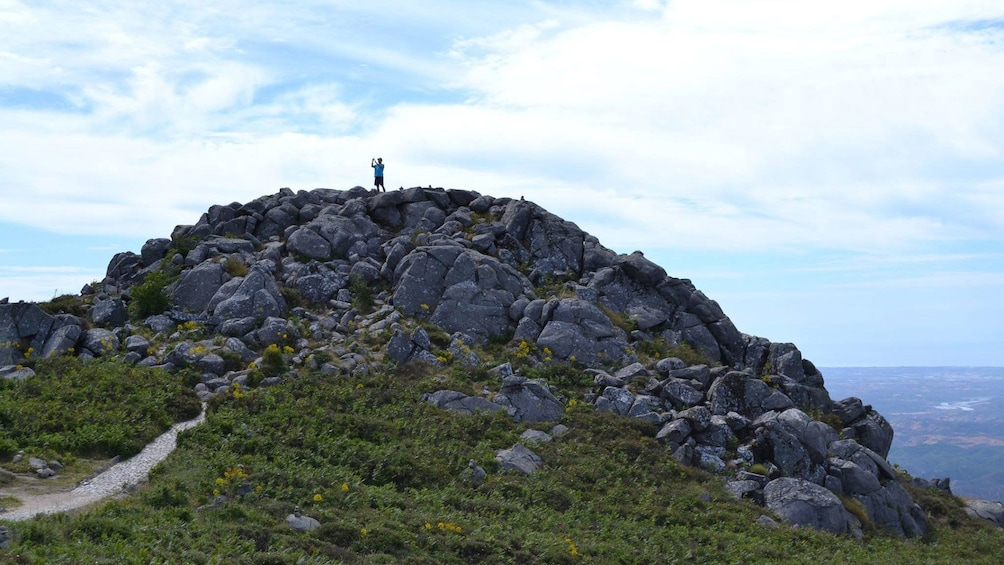 Man standing on top of Mount Fóia in Algarve