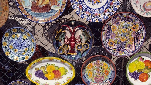 Colorful ceramic dishes for sale at the Loule outdoor marget in Loule