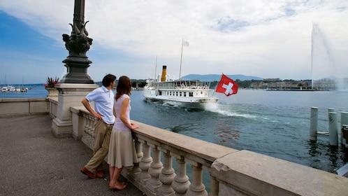 people observing boats in geneva