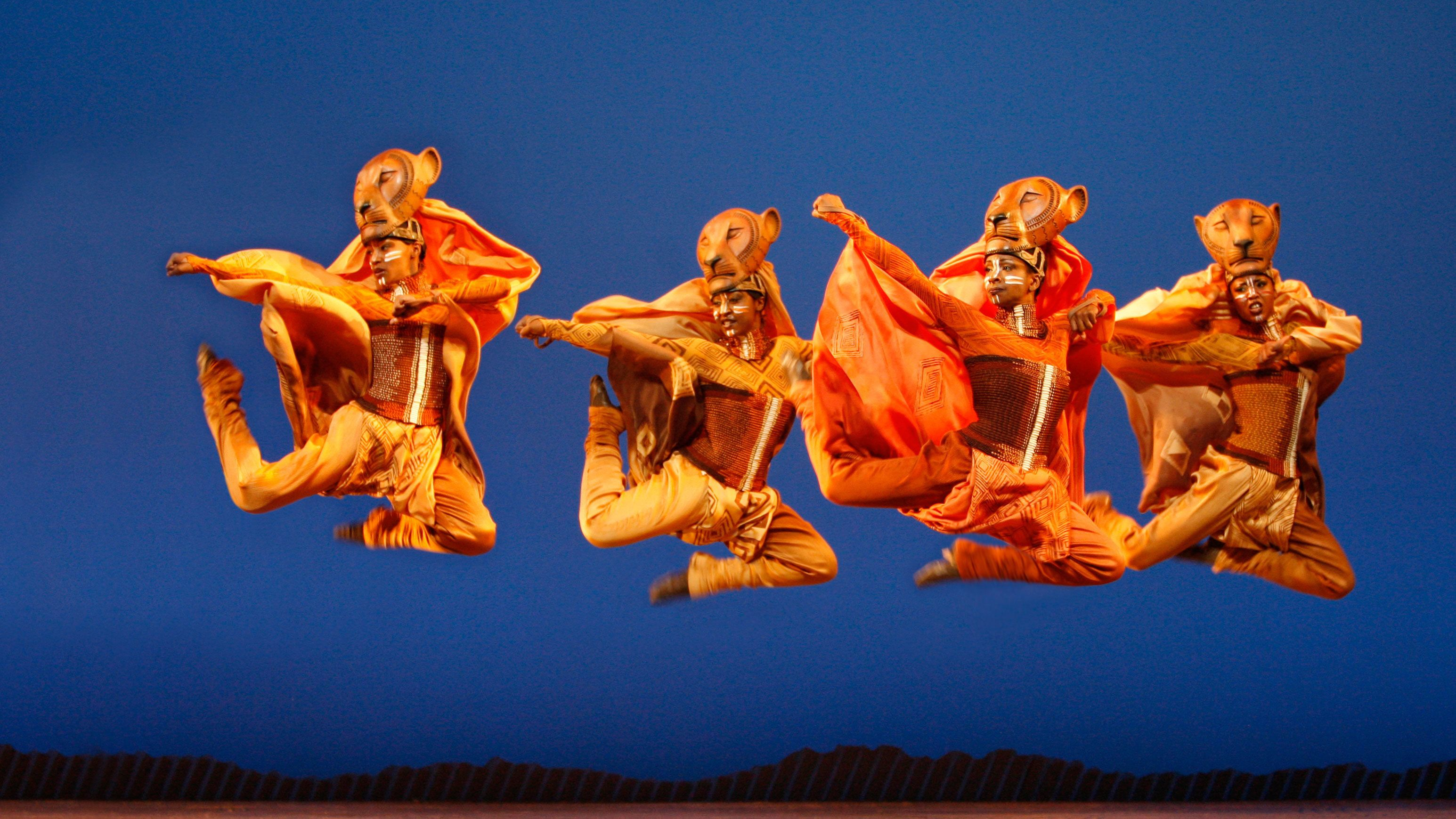 Lion dancers in The Lion King in New York