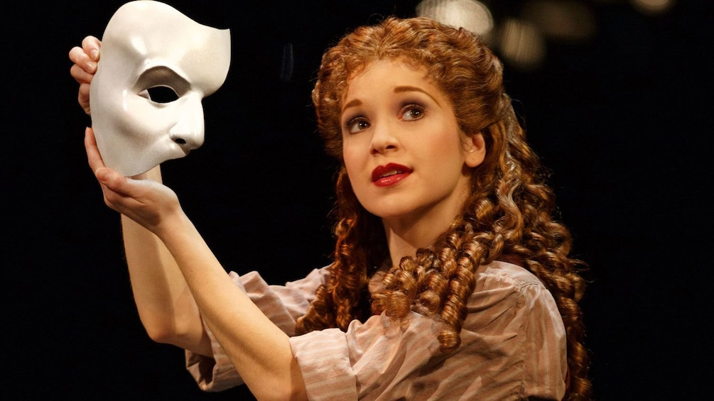 Show item 2 of 10. Actress with mask in The Phantom of the Opera on Broadway in New York
