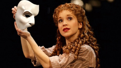 Actress with mask in The Phantom of the Opera on Broadway in New York