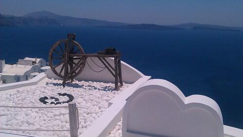 Spinning wheel on rooftop in Santorini