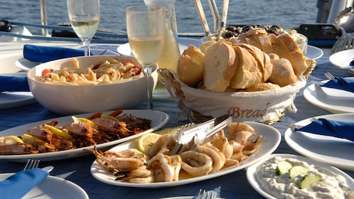 Plates of food on the table aboard a cruise boat on Santorini