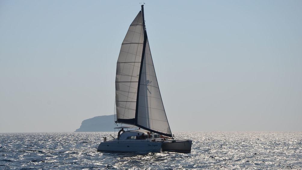 Charger l'élément 3 sur 7. Calming view of a catamaran on Santorini waters