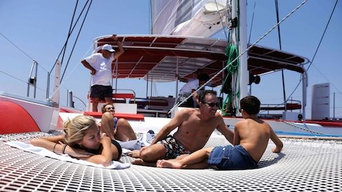 Family enjoying their time aboard a cruise boat in Santorini