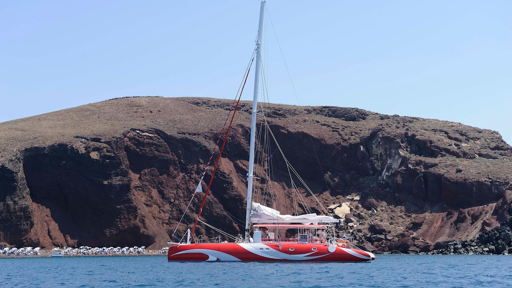 Show item 3 of 8. Catamaran sailboat in Santorini
