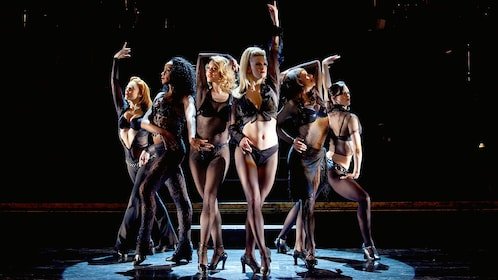 Group of five women in spotlight on the stage in Chicago, the musical
