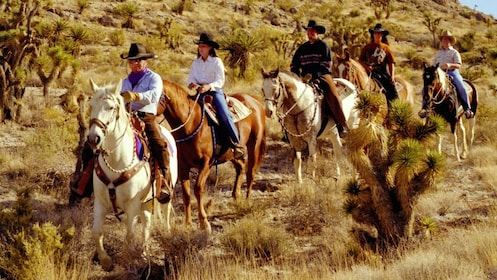 Horseback riders on a Wild West Horseback Riding tour in Las Vegas