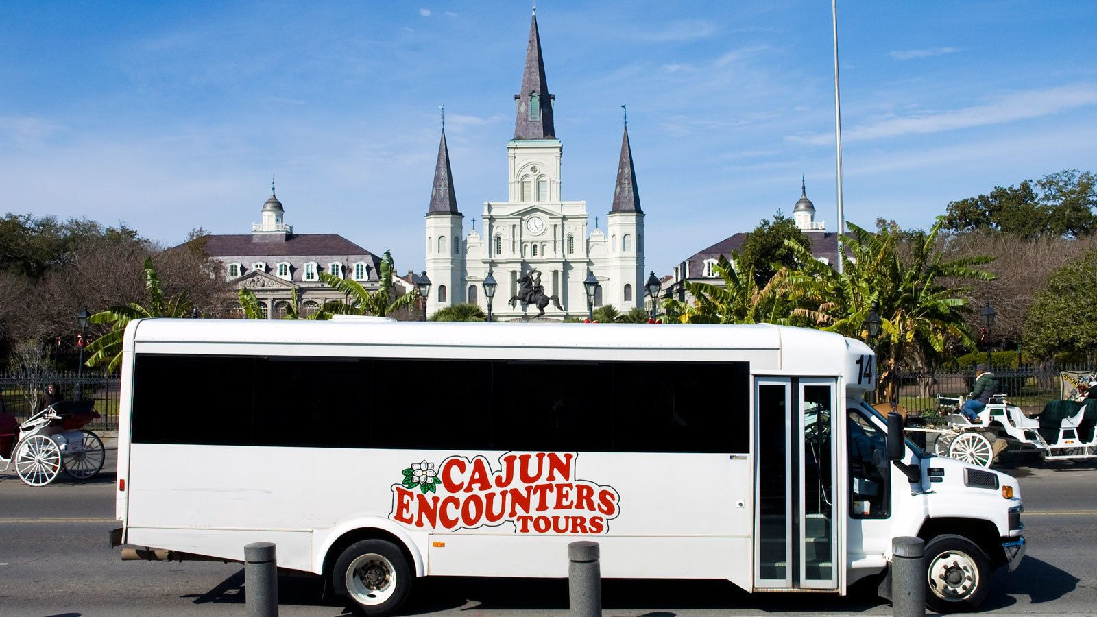 tour bus parked outside St. Louis cathedral in New Orleans