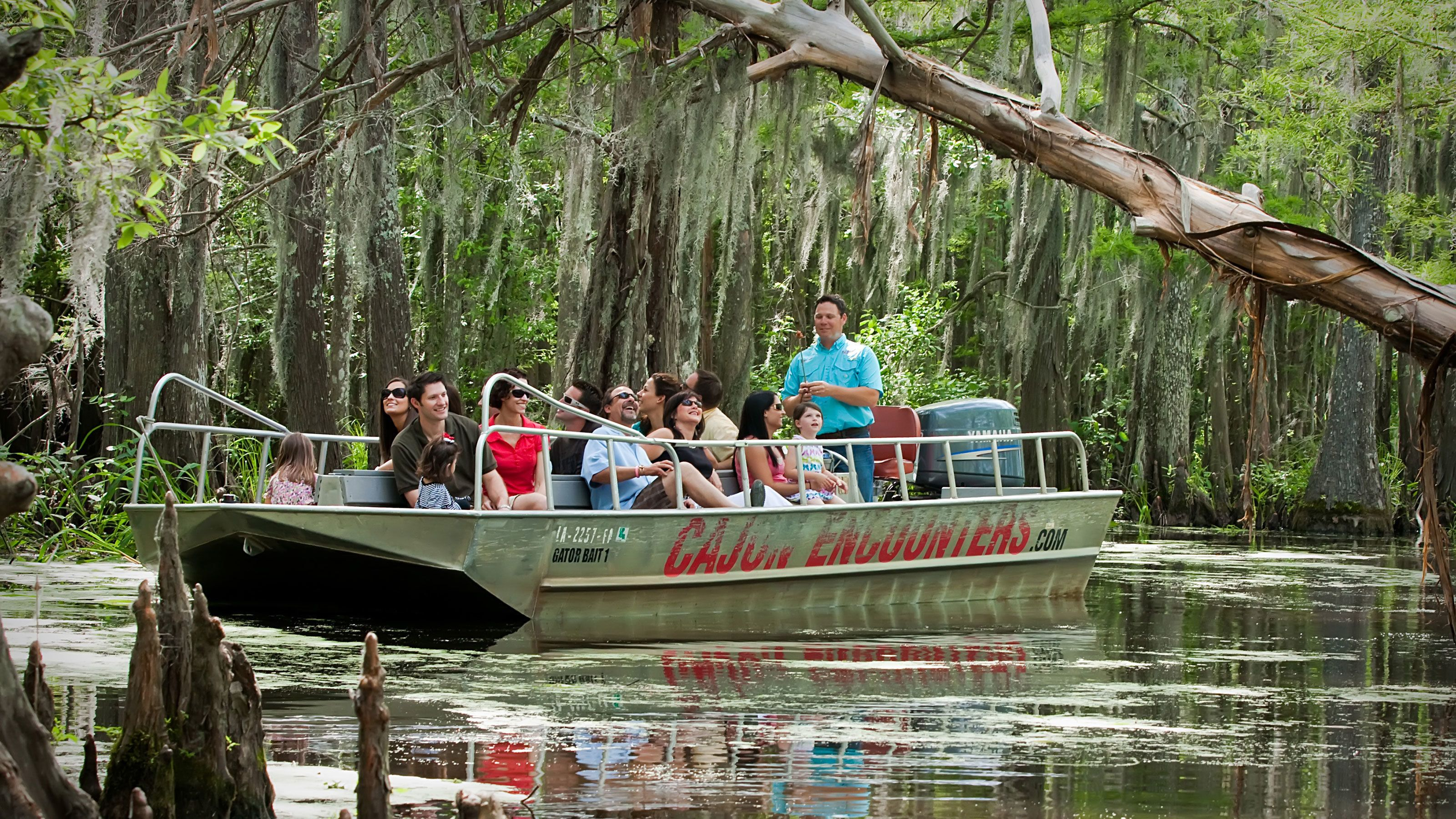 passengers on boat touring swamp lands in New Orleans