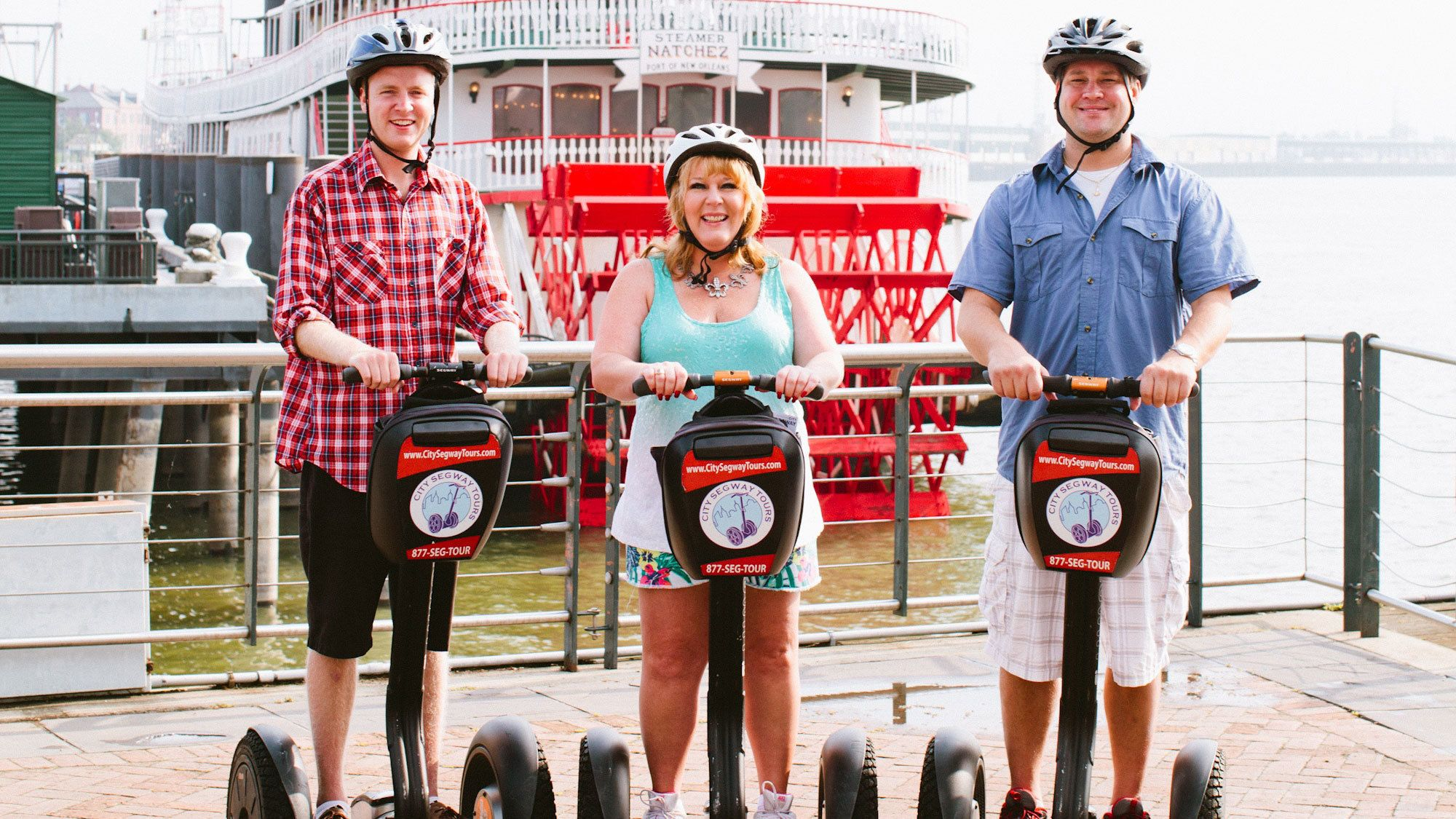 three people touring New Orleans on segways