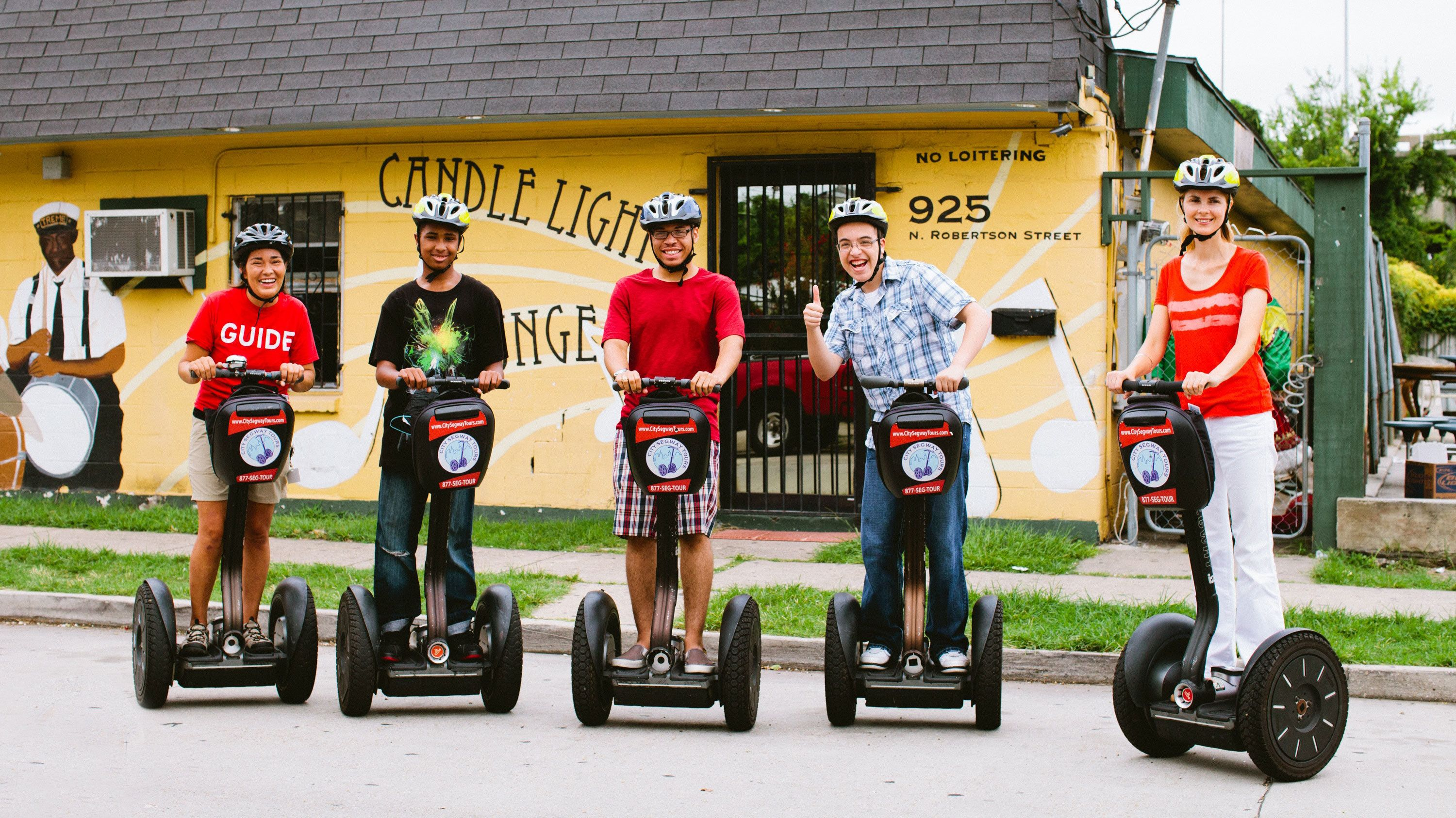 five people touring New Orleans on segways