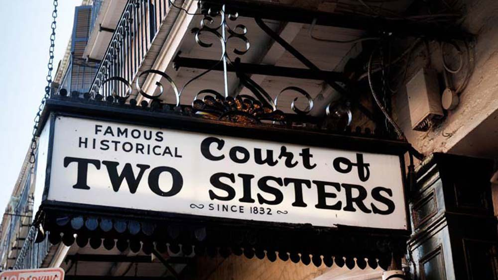 street sign for Court of Two Sisters in New Orleans