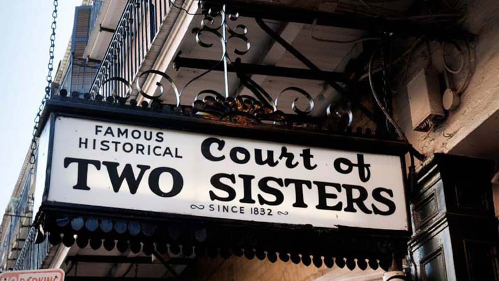 Show item 1 of 5. street sign for Court of Two Sisters in New Orleans