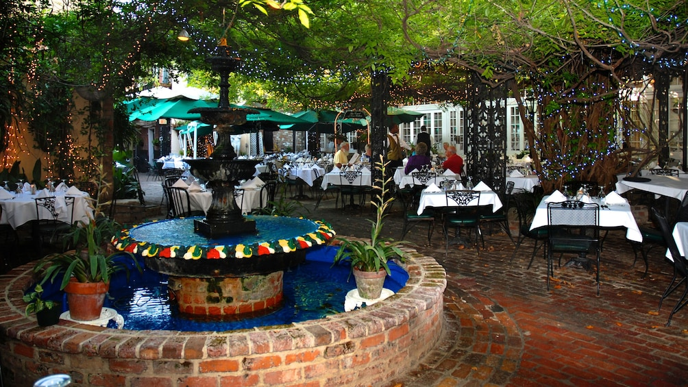 Show item 4 of 5. outdoor terrace dinning at Court of Two Sisters in New Orleans