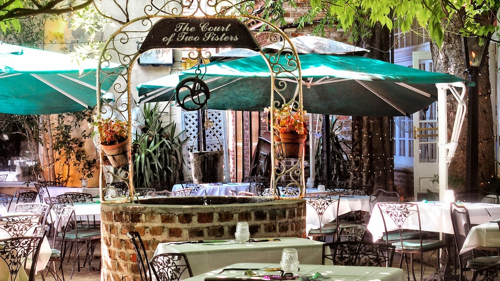 Show item 2 of 5. outdoor terrace dinning at Court of Two Sisters in New Orleans