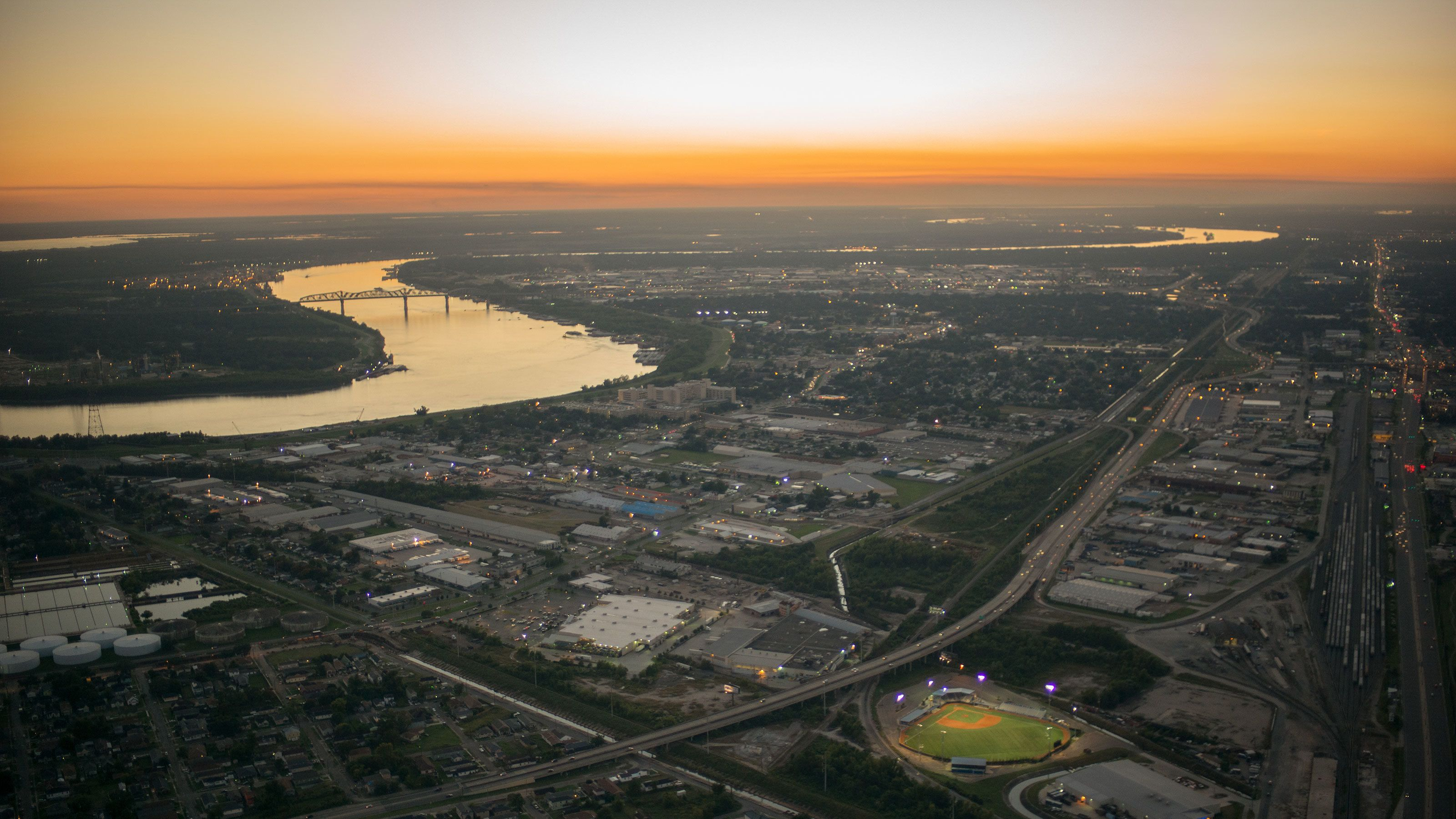 ariel view of river and sunset in New Orleans